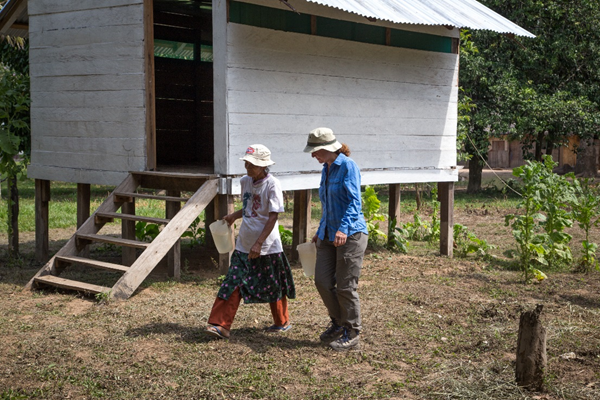 A volunteer with a local person in Bolivia