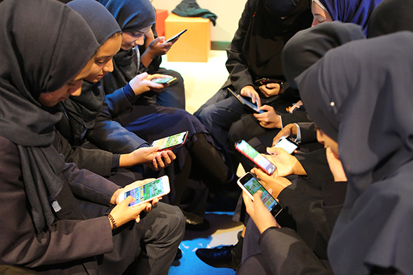Girls from Manchester Islamic girls school play virtue reality at the national video game museum in Sheffield