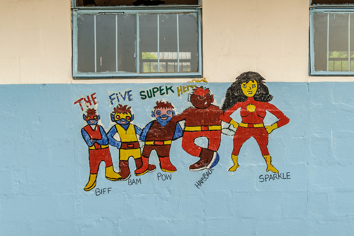 Sightsavers superheroes painted on wall
