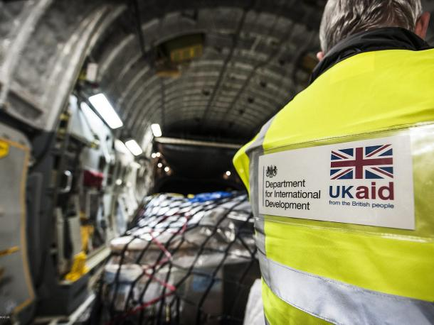 DFID worker checking supplies on a plane bound for the Philippines
