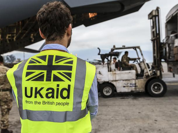 DFID staff member supervises the unloading of UK aid in Kathmandu