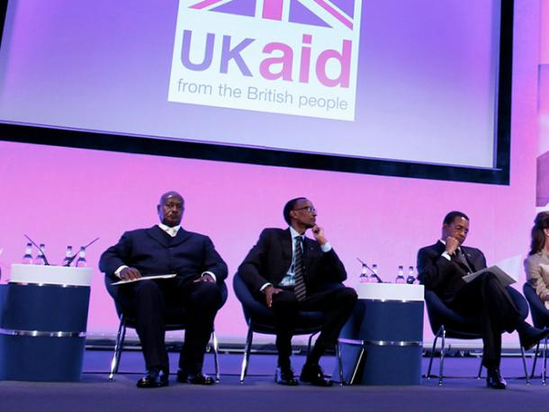 International Development Secretary Andrew Mitchell (second from right) looks on as Prime Minister David Cameron addresses the audience at the London Summit on Family Planning in 2012