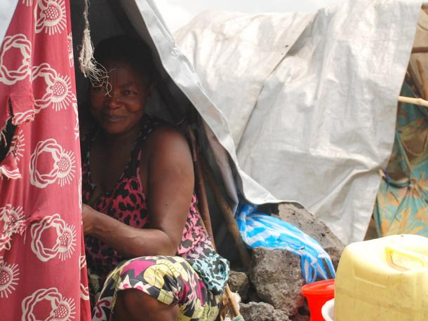 A woman in her shelter in Kanyaruchinya