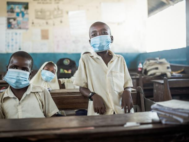 Africa children in classroom with masks
