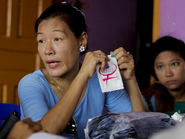 Woman holding a female condom