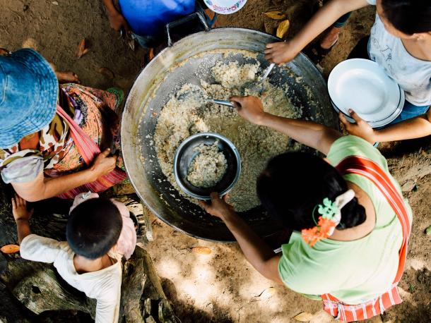 People cooking rice in Thailand