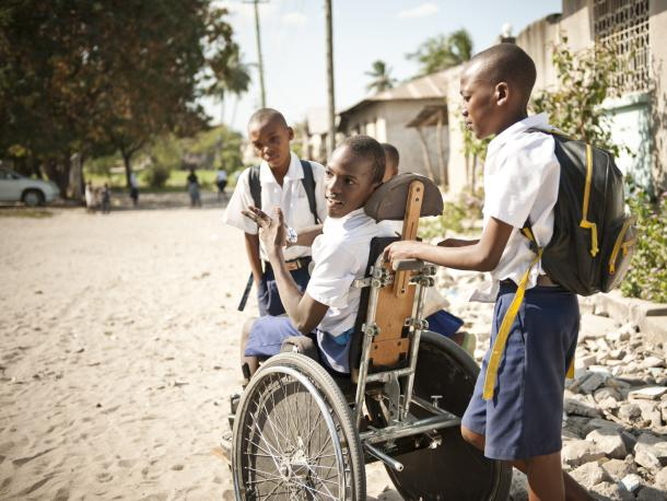 Boy with Cerebal Palsy in his wheelchair with friends