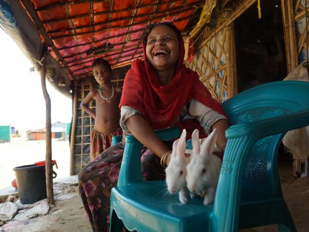 Refugee woman with her rabbits in Bangladesh