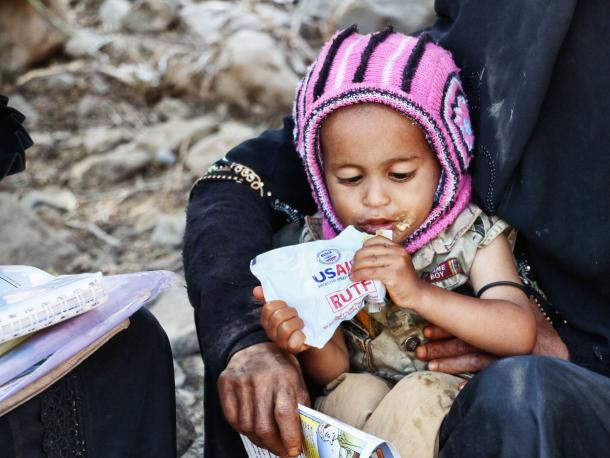 Child in Yemen eating food