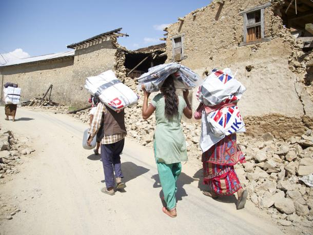 Women carrying UK aid bags in Nepal