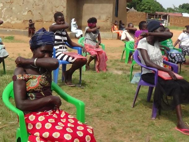 Women in South Sudan practice safe coughing. Photo credit: Women for Women International