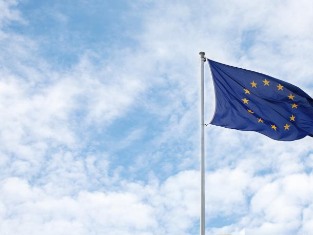 European Union flag against blue sky