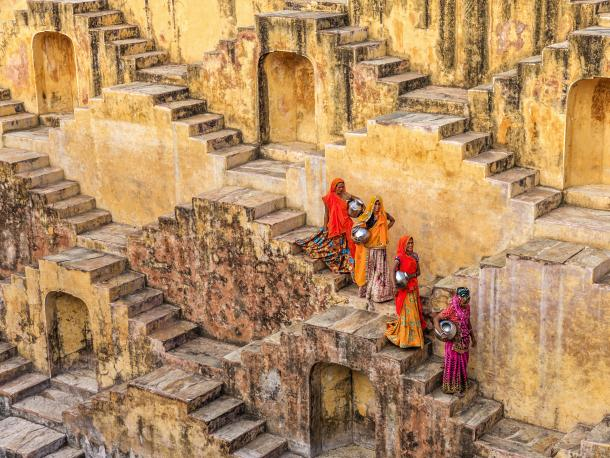 Women carrying water from stepwell near Jaipur
