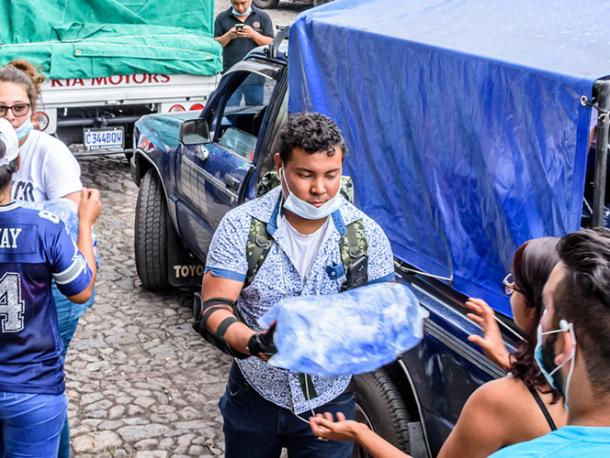 Volunteers load supplies outside town hall in Antigua, Guatemala to take to area affected by eruption of Fuego (fire) volcano