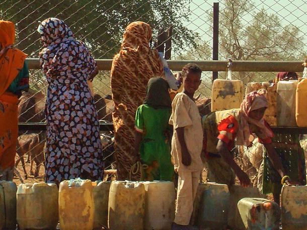 Sudanese women waiting in line to fetch water in Al Fashir, capital of North Darfur, Sudan.
