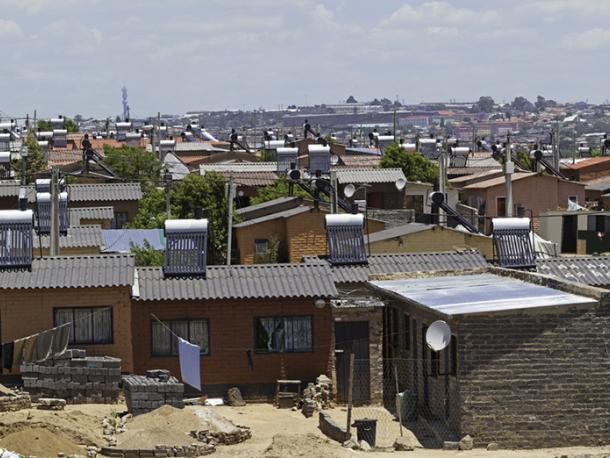 Alexander Township in Johannesburg, South Africa, showing new low cost homes fitted with Solar Power for hot water geysers.