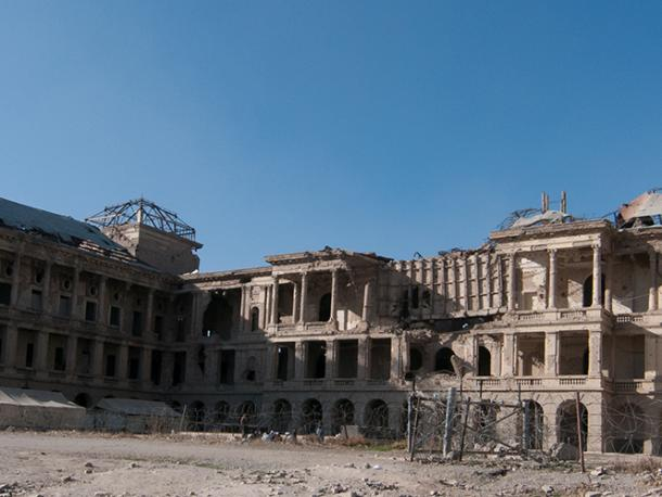 Aman Palace, Kabul. Formerly the Ministry of Defence, the building was badly damaged in shelling and mortar fire in the Mujahideen era. It has been demined and internally displaced people now live in the ruins.