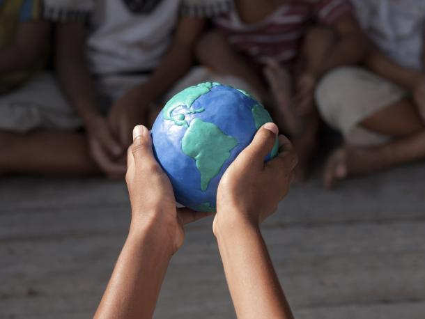 Small globe in child's hands