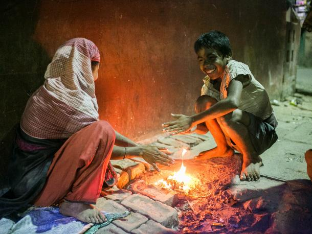 Two people in Kolkata with a fire