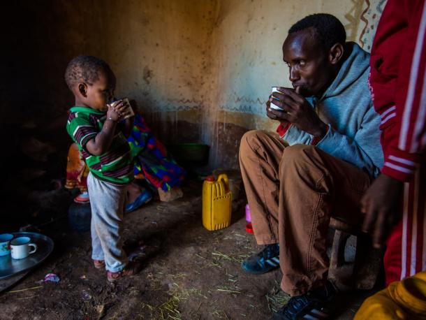 Man and child drinking tea