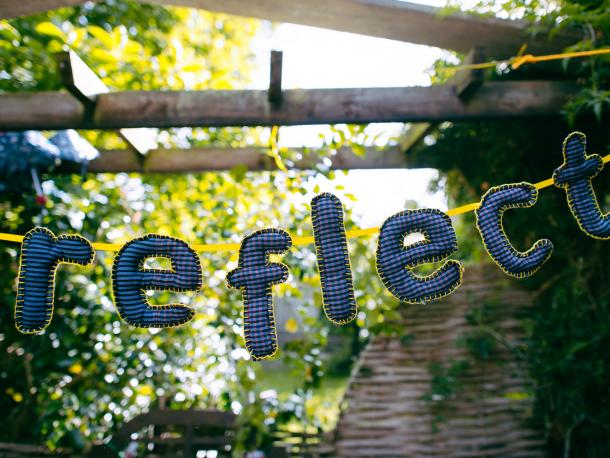 The word reflect made out of bunting