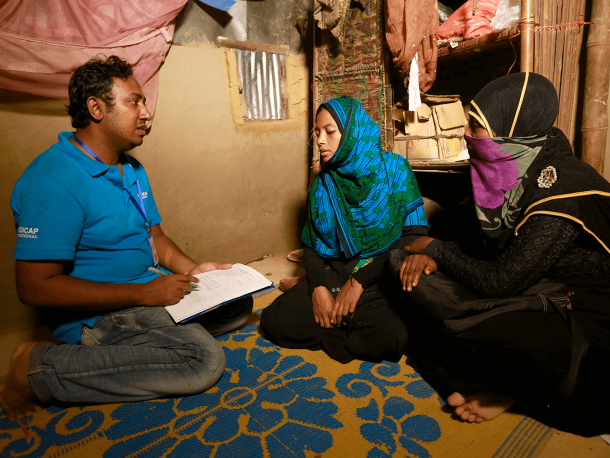 Man conducting an assessment with two women
