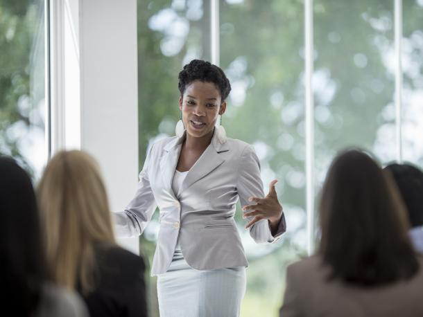 A woman presenting to colleagues