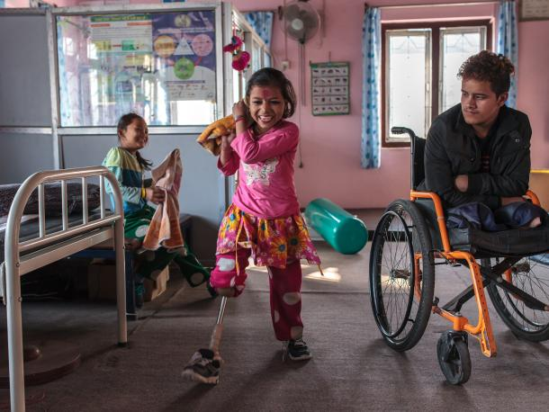 Nirmala practices walking with her new leg at the National Disabled Fund in Nepal