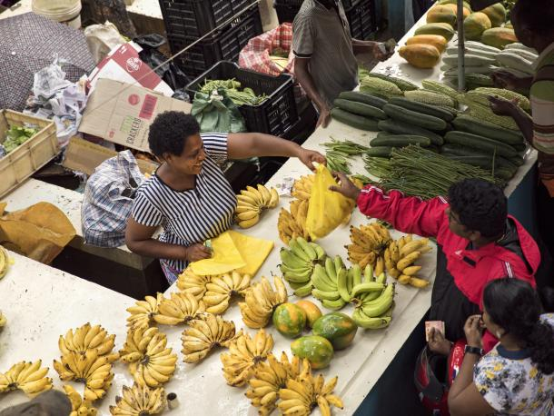 Market vendor selling bananas in Seychelles