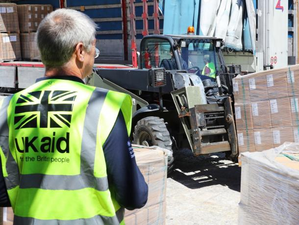 UK aid worker overseeing delivery