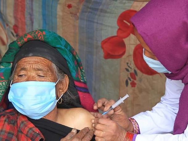 An 81 year old women receiving a vaccine in Nepal.