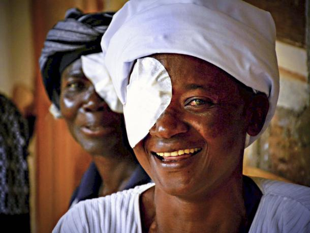 Woman in Kenya waiting to have eye patch removed after surgery by The Fred Hollows Foundation
