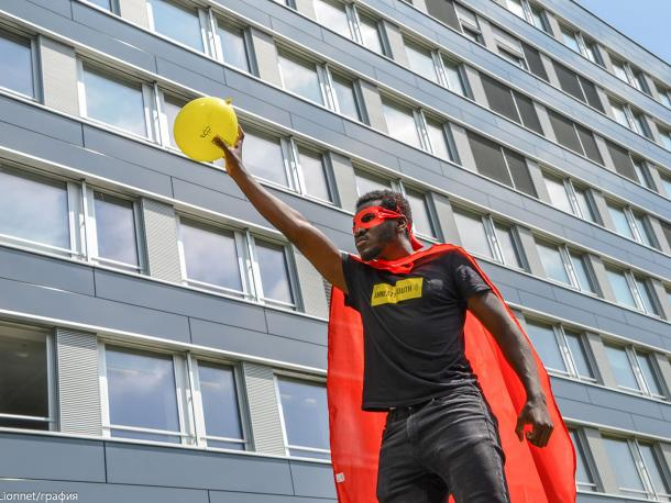 Youth activist dressed as a superhero in Berne, Switzerland