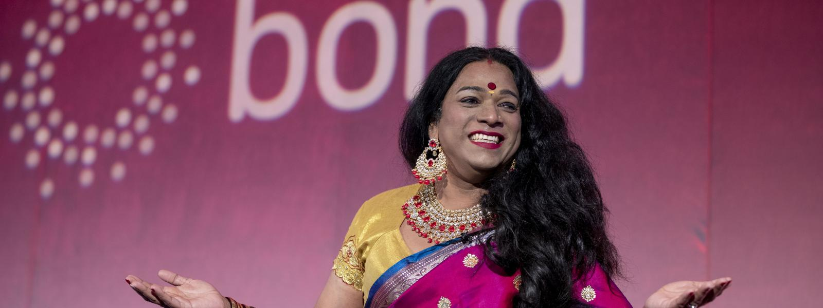 Indian trans activist Abheena Aher on stage at Bond Conference
