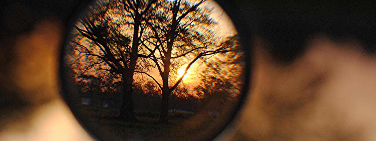 Sunrise viewed through a magnifying glass