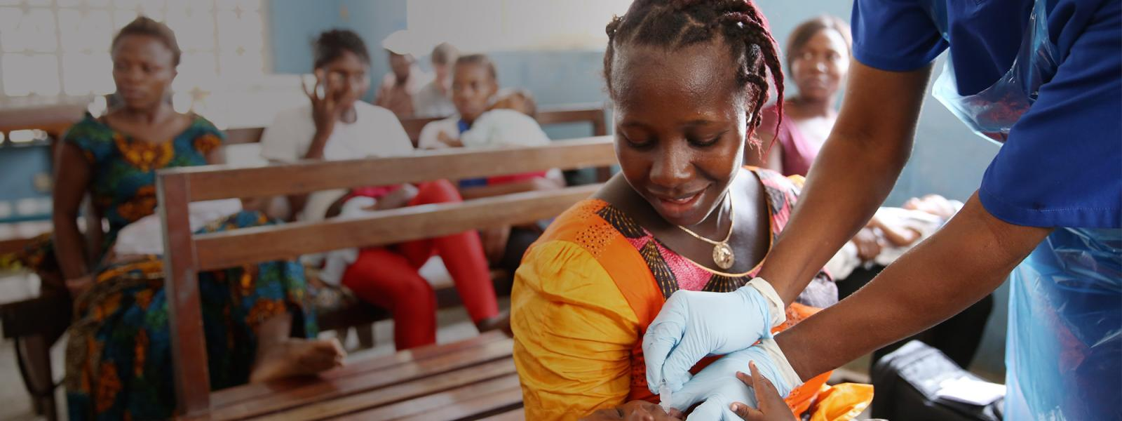 Baby in Sierra Leone gets vaccination