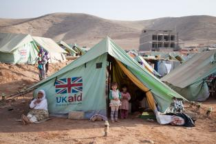 Family in shelter provided by UK aid for people displaced by Daesh