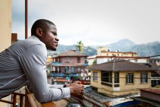Ebola survivor looks out over Freetown