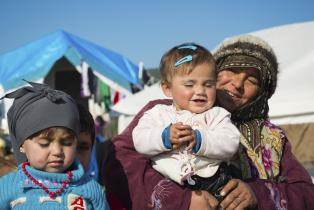 Internally displaced Syrians, an adult and children, at a camp for displaced persons near the Turkish border in Atmeh, Syria