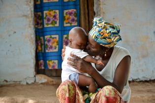 Mother holding young baby in The Gambia