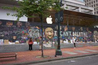Graffiti of George Floyd outside an Apple Store